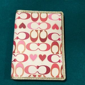 Woman's pink/burgundy heart coach wallet